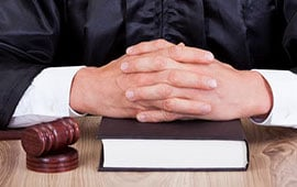 mark-hogan-toronto-criminal-lawyer-toronto-hands-folded